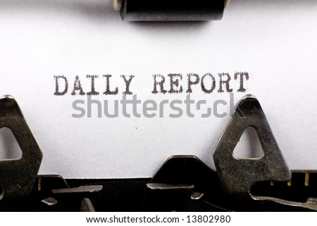Typewriter close up shot, concept of Daily Report - stock photo