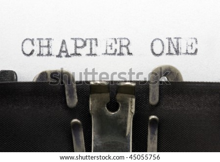Typewriter closeup shot, concept of Chapter one - stock photo