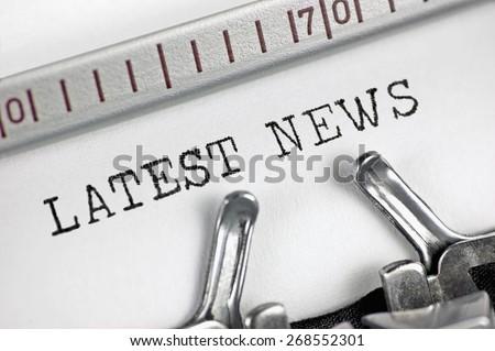 Typewriter detailed macro closeup text Latest News, large vintage press, TV, radio, internet mass media journalism metaphor, newspapers, magazines, broadcasting television journalist concept  - stock photo