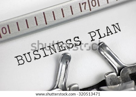 Typewriter detailed macro closeup typing text Business Plan, large vintage metaphor, success, analysis, marketing, strategy, financial, market growth planning objectives management concept, horizontal - stock photo