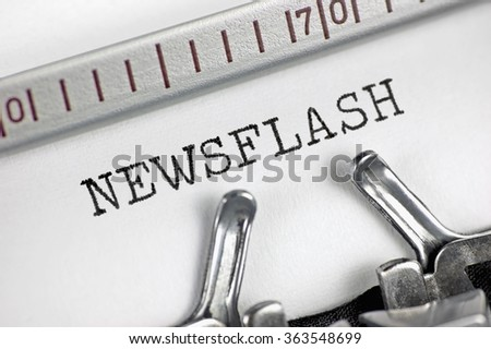 Typewriter detailed macro closeup typing text Newsflash large detail vintage press TV radio internet mass media journalism metaphor newspapers magazines broadcasting journalist news flash concept - stock photo
