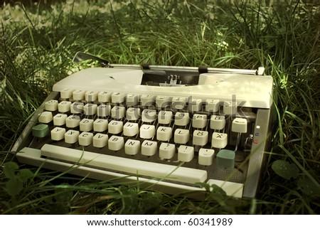Typewriter in grass - stock photo