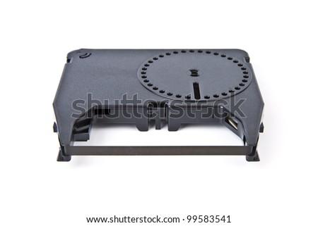 Typewriter ribbon reel isolated on white background - stock photo