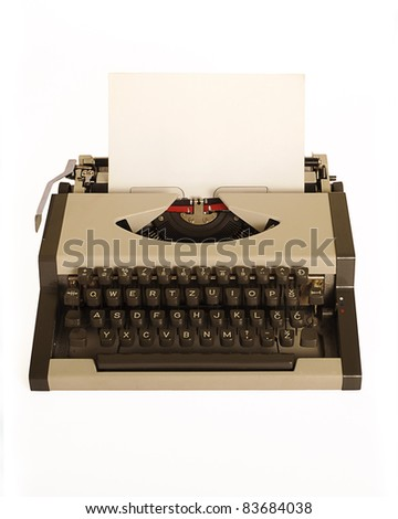 Typewriter with a blank piece of paper, isolated on white - stock photo