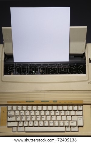 Typewriter with a piece of paper inserted. - stock photo
