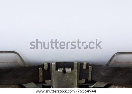 Typewriter with blank sheet - stock photo