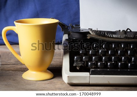 Typewriter with coffee cup. - stock photo