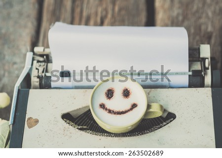 Typewriter with coffee cup, sepia tone. - stock photo