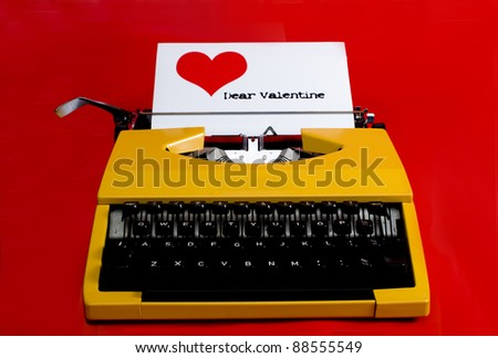 typewriter with dear valentine note being typed - stock photo