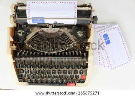 Typewriter with sheet of paper. Isolated on white background with  - stock photo