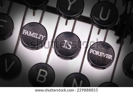 Typewriter with special buttons, family is forever - stock photo