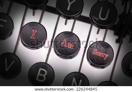 Typewriter with special buttons, I am sorry - stock photo