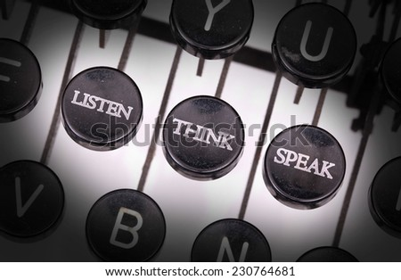 Typewriter with special buttons, listen think speak - stock photo
