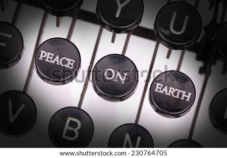 Typewriter with special buttons, peace on earth - stock photo