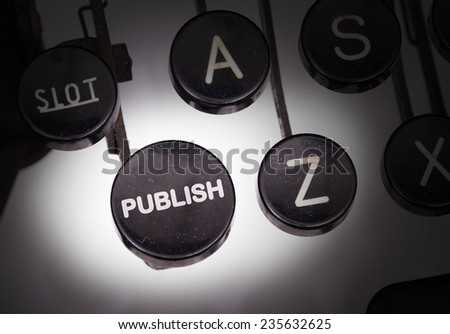 Typewriter with special buttons, publish - stock photo