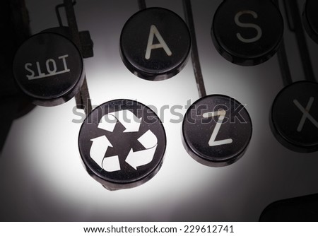 Typewriter with special buttons, recycle - stock photo