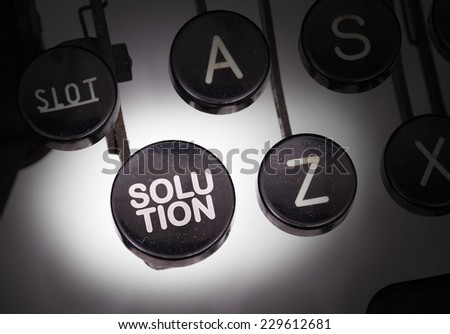 Typewriter with special buttons, solution - stock photo