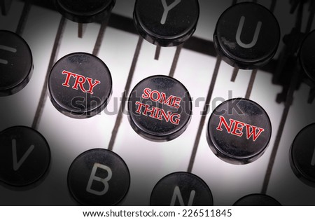 Typewriter with special buttons, try something new - stock photo