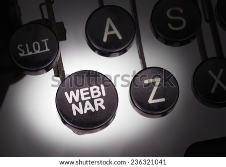 Typewriter with special buttons, webinar - stock photo