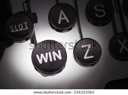 Typewriter with special buttons, win - stock photo