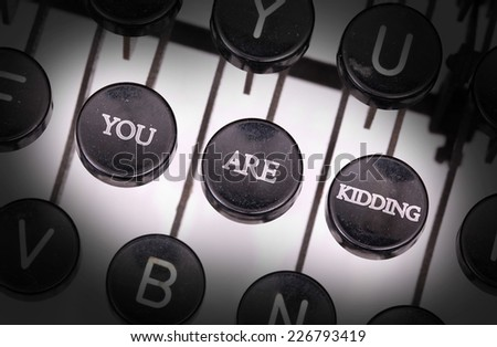 Typewriter with special buttons, you are kidding - stock photo