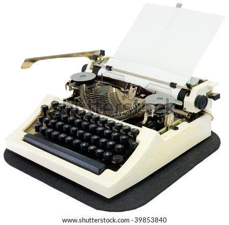 Typewriter with the inserted leaf of a paper in the carriage - stock photo