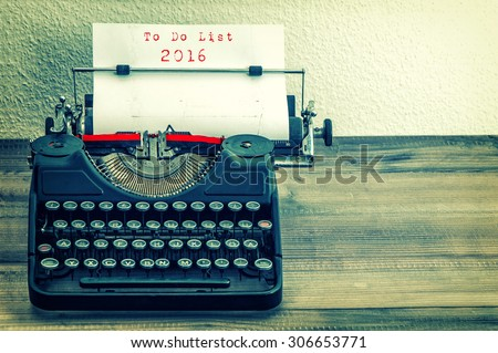 Typewriter with white paper page on wooden table. sample text  To Do List 2016. Vintage style toned picture - stock photo
