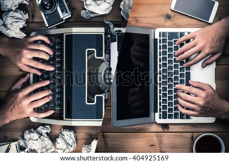 Typewriters and laptop - stock photo