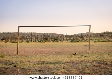 Typical African football field for playing soccer in rural Botswana, Africa - stock photo