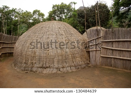 Typical African thatched cottages in Manzini. Swazi, Swaziland - stock photo
