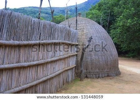 Typical African thatched cottages in Manzini.  Swaziland - stock photo