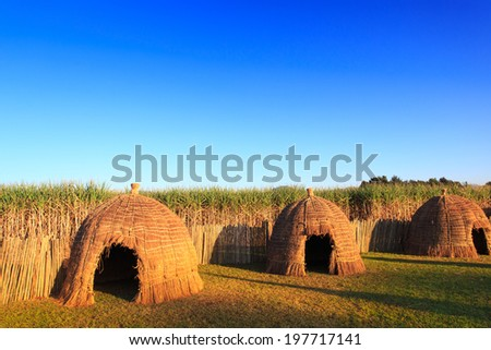 Typical African thatched traditional houses in Swaziland - stock photo