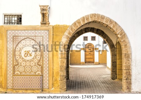 Typical alley in a Moroccan town - stock photo