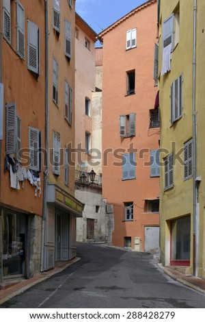 Typical alley in the old town of Grasse, a commune in the Alpes-Maritimes department on the French Riviera. The town is considered the world's capital of perfume - stock photo