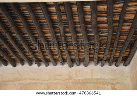 Typical ancient wooden roof on display at an old fort in Qatar