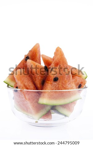 Typical and delicious slice of watermelon with whole watermelon - stock photo