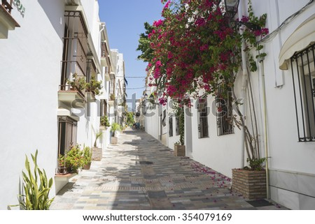 typical Andalusian streets and balconies with flowers in Marbella Andalucia Spain - stock photo