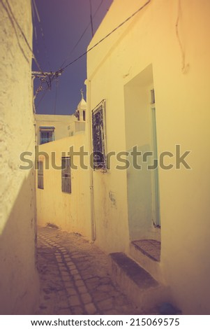 Typical arabic streets and buildings. Medina. Tunisia. Filtered image:cross processed vintage effect.  - stock photo