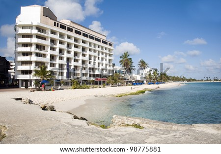 typical architecture high rise beach palm trees San Andres Island Colombia South America - stock photo
