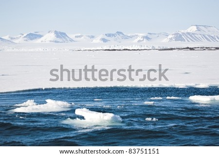 Typical Arctic winter landscape - mountains, sea, glaciers