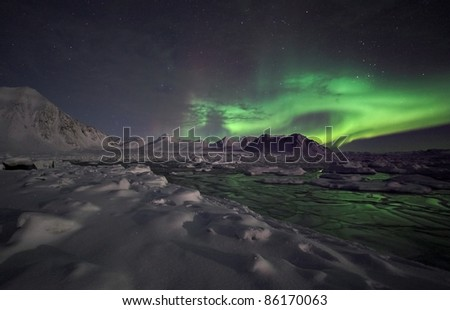 Typical Arctic winter night landscape - Northern Lights - stock photo