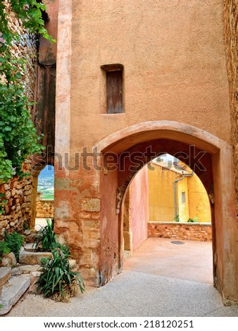Typical arhitecture in beautiful medieval village Roussillon, Provence, France - stock photo