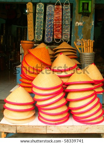 Typical asian hats sold at Jakarta market, Indonesia