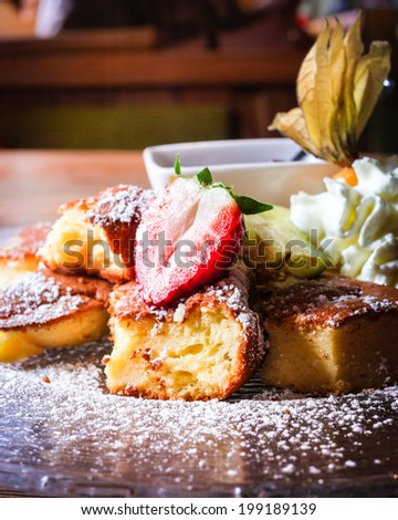 Typical austrian or german pancake dessert with berries and whipped cream - stock photo