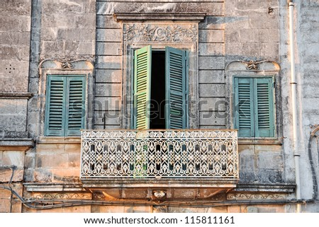Typical balcony in baroque style in urban centre of Cisternino's town, in Apulia. Italy - stock photo