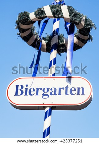 typical bavarian maypole - closeup - photo - translation: beer garden - stock photo