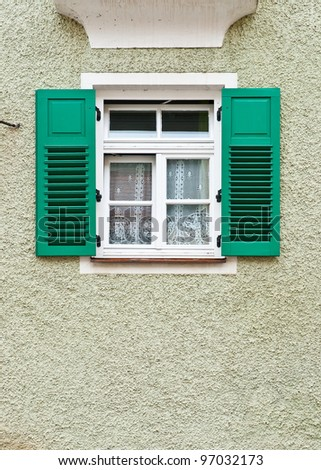 Typical Bavarian Window with Open Wooden Shutters - stock photo