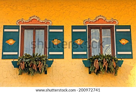 typical bavarian windows with green shutters and winter decorations, Austria - stock photo