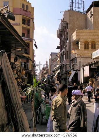 Typical bazaar scene of merchants  bargaining in the Bazaar or souk Khan el-Khalili,  Cairo, Africa - stock photo