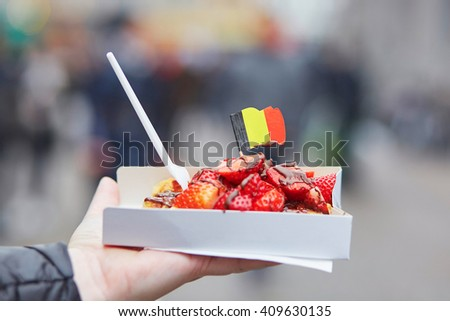 Typical belgian waffle in the street, ready to eat.